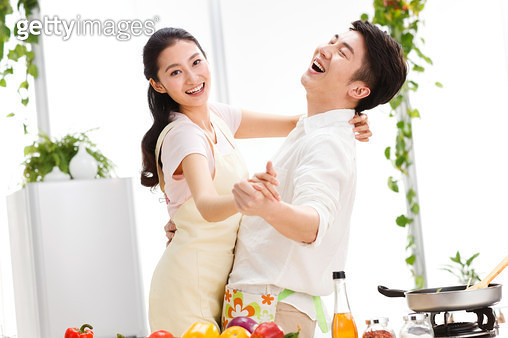 Happy couple in kitchen - gettyimageskorea