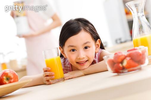 Happy kid in kitchen - gettyimageskorea