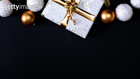 Christmas presents with gold ribbon on dark wooden background in vintage style. - gettyimageskorea