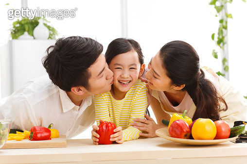 Happy family in kitchen - gettyimageskorea