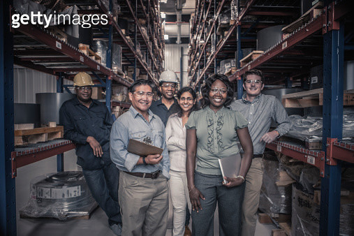 Workers standing together in factory - gettyimageskorea