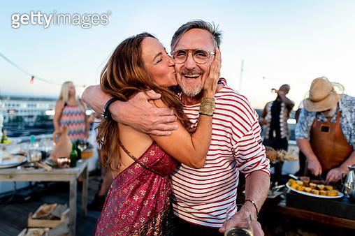 age contrast couple are happy on a rooftop party - gettyimageskorea