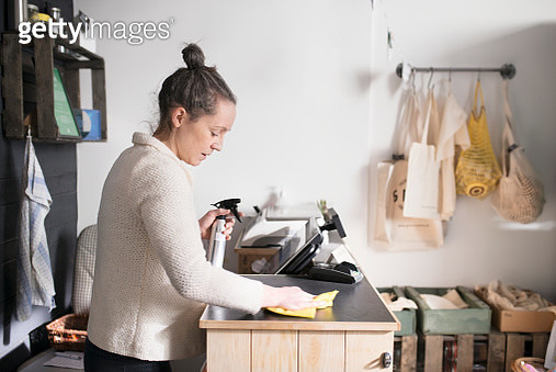 Woman working in shop - gettyimageskorea