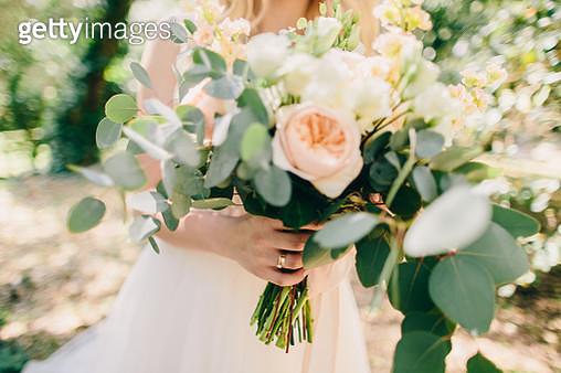 Midsection Of Bride Holding Flower Bouquet - gettyimageskorea