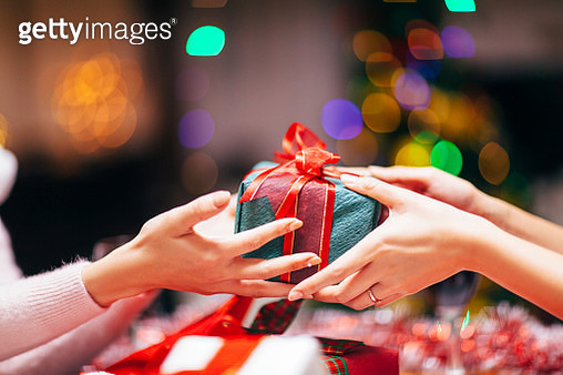 Hands Giving Gift Close-up - gettyimageskorea