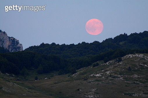 Pink full moon over Campo Imperatore, Abruzzo, Italy, Europe. - gettyimageskorea