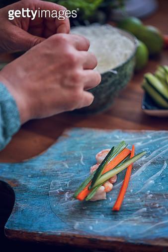 Preparing Spring Rolls with Vegetables and Shrimps - gettyimageskorea