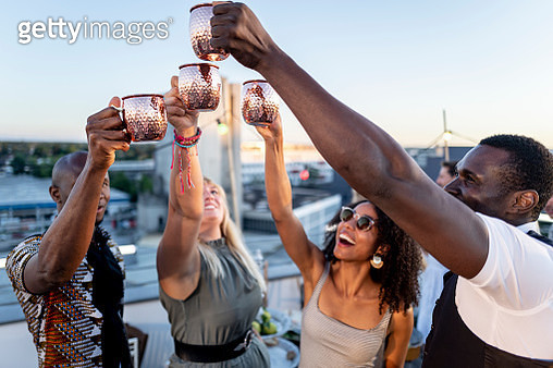 urban rooftop party - trendy group of people partying together - gettyimageskorea