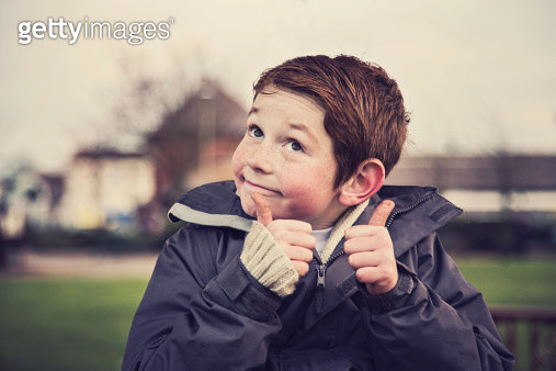 Happy smiling little boy with his thumbs up - gettyimageskorea