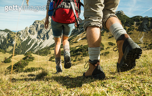 Austria, Tyrol, Tannheimer Tal, close-up of young couple hiking - gettyimageskorea