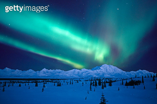 Aurora Borealis over Denali in winter, composite - gettyimageskorea