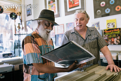 Elderly customer searching record bin - gettyimageskorea