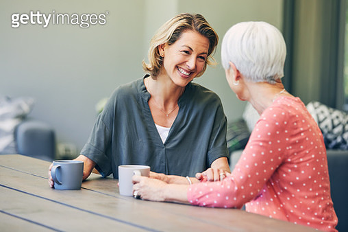 Shot of a mature woman and her elderly mother having coffee and a chat at home - gettyimageskorea