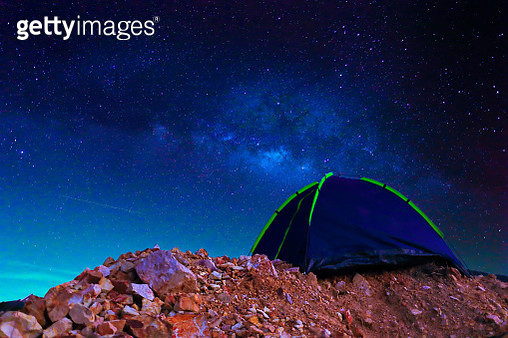 camping tent on mountain Milky way.Camping concept. - gettyimageskorea