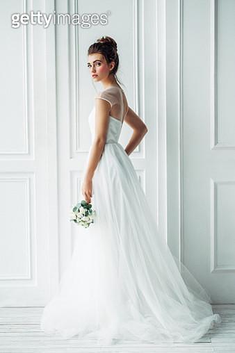 Beautiful brunette woman as bride with wedding bouquet - gettyimageskorea