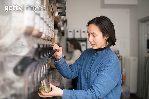 Woman working in organic shop - gettyimageskorea