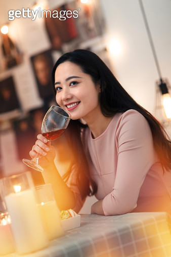 Young woman for dinner - gettyimageskorea