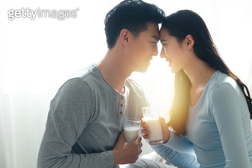 Young couples to drink milk - gettyimageskorea