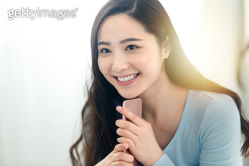 Happy young woman - gettyimageskorea