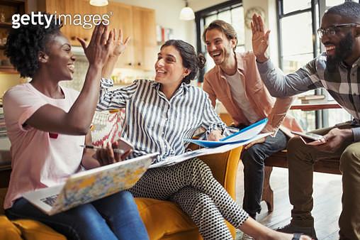 Creative business people high-fiving in meeting - gettyimageskorea