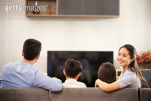 Happy families are watching TV - gettyimageskorea