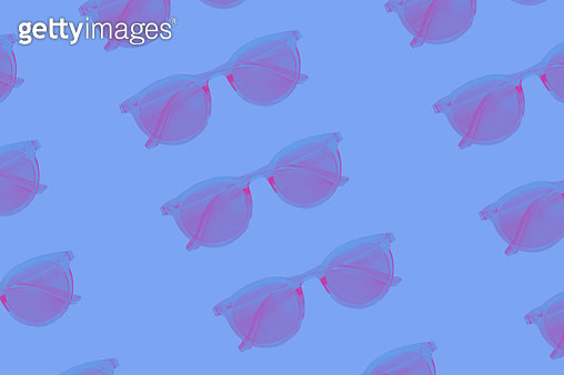 Pattern made of pink neon sunglasses ober blue background. Trendy 90s new wave style picture. - gettyimageskorea