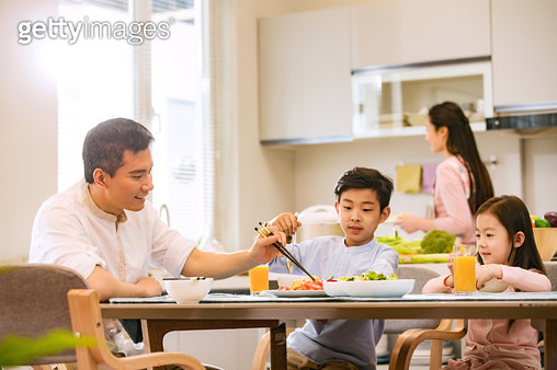 Happy family at dinner - gettyimageskorea