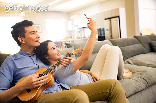 Romantic couples in the living room - gettyimageskorea