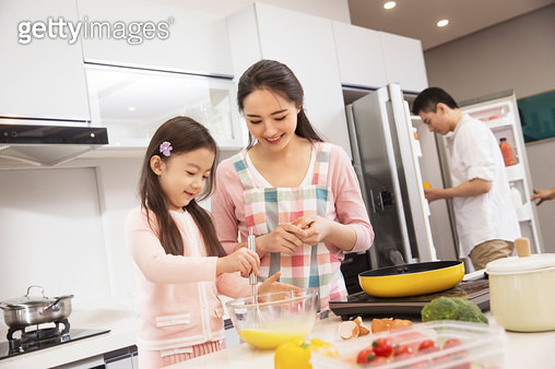 A happy family in the kitchen - gettyimageskorea