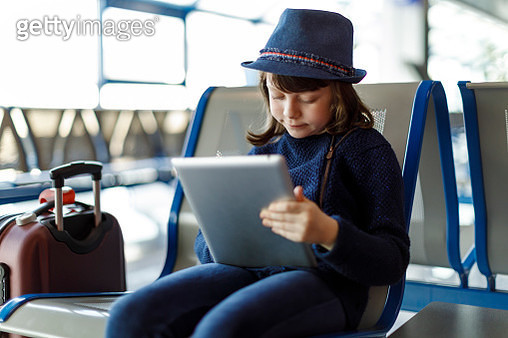 Cute girl  waiting for the plane - gettyimageskorea