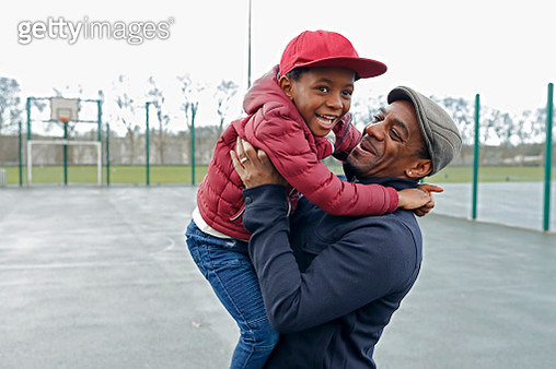 Father and son laughing and playing in the park together - gettyimageskorea