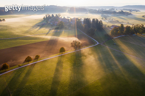 Germany, Bavaria, Ried near Dietramszell, ground fog at sunrise, drone view - gettyimageskorea