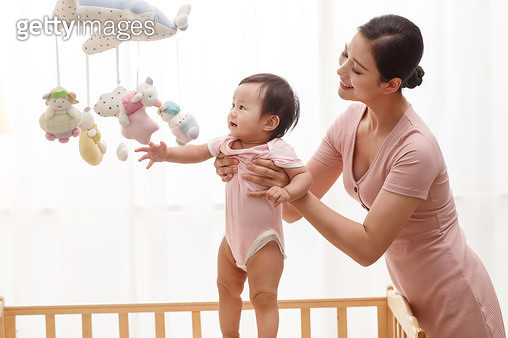 Mother got the baby to play - gettyimageskorea
