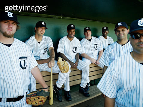 Professional baseball team sitting in dugout - gettyimageskorea