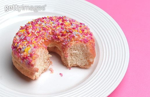in a hurry donut left half finished - gettyimageskorea