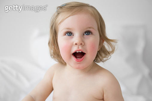 Portrait of singing blond toddler girl - gettyimageskorea