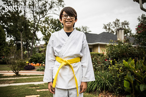 Young boy in karate gi - gettyimageskorea