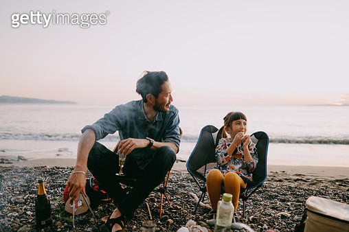 Father and preschool daughter camping at beach, Tokyo Bay - gettyimageskorea