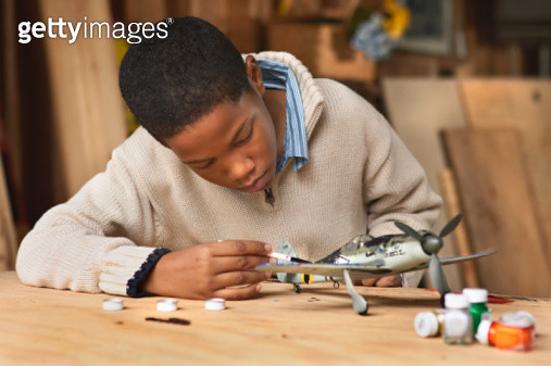 Boy Painting Model Airplane - gettyimageskorea