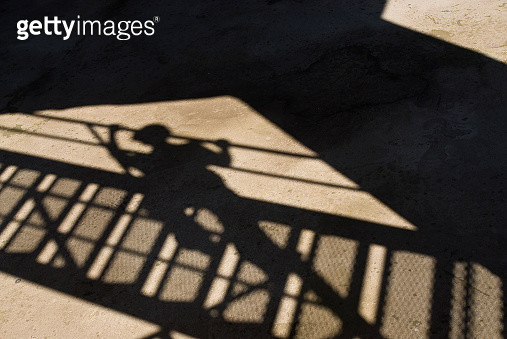 man shadow at stair - gettyimageskorea