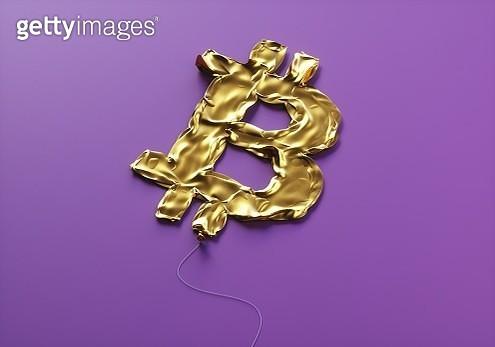 Bitcoin sign balloon deflated - gettyimageskorea