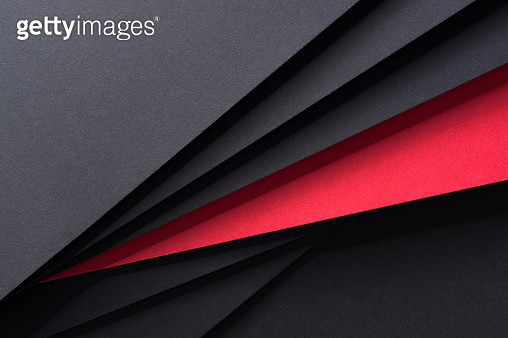 Isolated Red Paper Standing Out From Black Paper. - gettyimageskorea