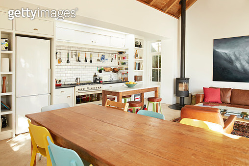 Wooden dining table arranged against kitchen counter at home - gettyimageskorea