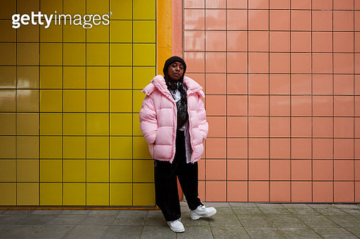 Woman stands at subway station - gettyimageskorea