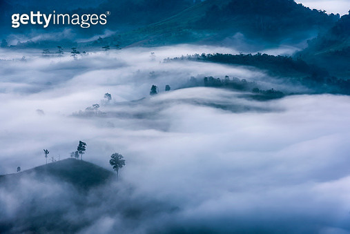 Mountains and mist at sunrise - gettyimageskorea
