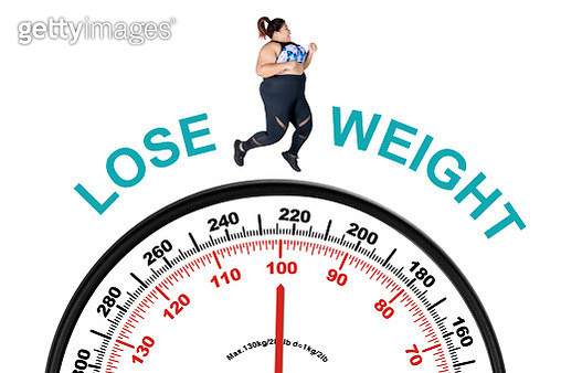 Digital Composite Image Of Woman Running Over Weight Scale With Text Against White Background - gettyimageskorea