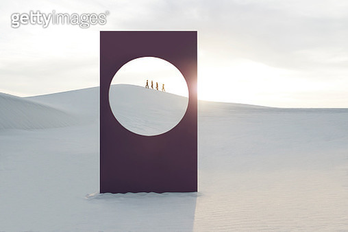 Mid distance view of female models walking at white desert seen through window frame - gettyimageskorea
