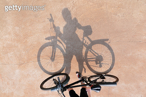 Shadow of the bicycle and the girl - gettyimageskorea