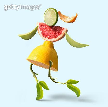 Running women's figure form by citrus fruit slice. - gettyimageskorea