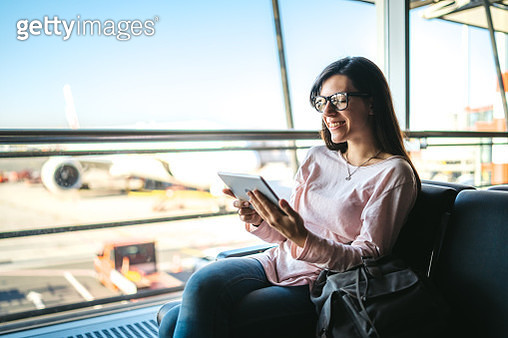 Watching movie at the airport - gettyimageskorea